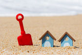 Beach huts and toys — Stock Photo