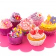 Stock Photo: Colorful cupcakes on tray
