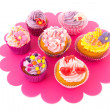 Colorful cupcakes on tray — Stock Photo #31062985