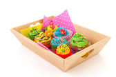 Colorful cupcakes on wooden tray — Stok fotoğraf