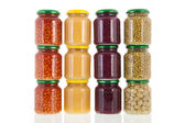 Row pots with canned vegetables — Stock Photo