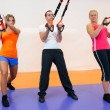 Stok fotoğraf: Young womdoing suspension training