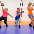 Stock Photo: Young woman doing suspension training
