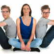 Stock Photo: Adult male twins and young girl