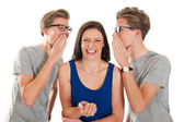 Gossip by twins with a girl — Stock Photo