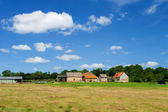 French farmhouse in landscape — Stock Photo