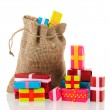Jute bag with presents — Stock Photo