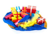 Hat of black Pete with many presents — Stock Photo