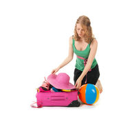 Packing the suitcase by a young woman — Stock Photo