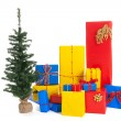 Many Christmas gifts with tree — Stock Photo