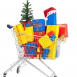 Gifts for Christmas in shopping cart — Stock Photo