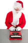 Santa Claus writing a letter — Stock fotografie