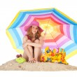 Sunbathing at the beach with colorful parasol — Stock Photo #35835141
