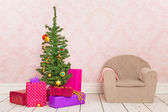 Vintage room with Christmas tree, gifts and chair — Stok fotoğraf