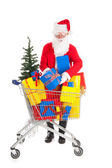 Santa Claus putting a gift in shopping caart — Stock Photo