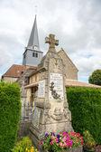 French church with war monument — Stock Photo