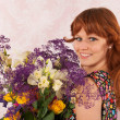 Woman with colorful flowers — Stock Photo