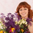 Woman with colorful flowers — Stock Photo #36076899