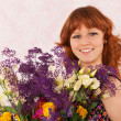 Stock Photo: Woman with colorful flowers