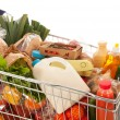 Shopping cart full dairy grocery — Stock Photo #36076917