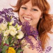 Woman with colorful flowers — Stock Photo #36076991