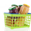 Preserved vegetables in shopping basket — Stock Photo