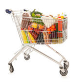 Shopping cart full dairy grocery — Stock Photo