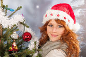 Winter woman with Christmas tree — Stock Photo