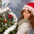 Winter woman with Christmas tree — Stock Photo #36372927
