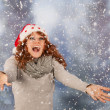 Winter woman with hat of Christmas Santa in snow — Stock Photo