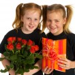 Little girls with presents — Stock Photo