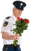 Police man with roses — Stock Photo