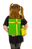 Hiding green luxury presents — Stock Photo