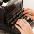 Writing with old black typewriter — Stock Photo #36732361