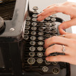 Writing with old black typewriter — Stock Photo #36732367