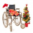 Empty wheelchair for Christmas party — Stock Photo