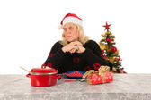 Woman of mature age alone with Christmas — Stock Photo