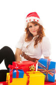 Woman with many Christmas gifts — Stock Photo