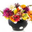 Colorful bouquet garden flowers in black vase — Stock Photo #37289479