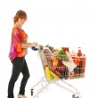 Woman with Shopping cart full dairy grocery — Stock Photo #37289627