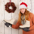 Woman in winter with ice skates and hat Santa Claus — Stock Photo #37289643