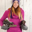 Womin winter with ice skates — Stock fotografie #37289649