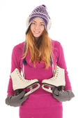Attractive woman with ice skates — Foto de Stock