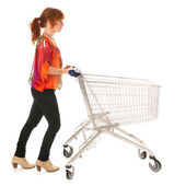 Woman with empty shopping cart — Foto de Stock