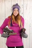 Woman in winter with ice skates — Stock Photo