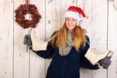 Christmas woman in winter with ice skates — Stock Photo
