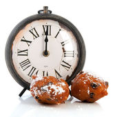Dutch traditional oliebollen and clock — Stock Photo