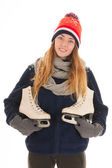 Attractive woman with ice skates — Stock fotografie