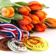 Dutch medals and orange tulips — Stock Photo