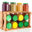 Wooden crate preserved vegetables — Stock Photo